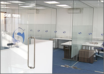 Glass partitioned offices and office pods